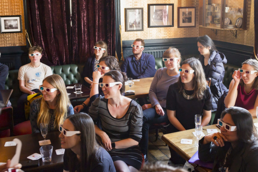 Science Communication: Crowd with 3D glasses in bar during Pint of Science event