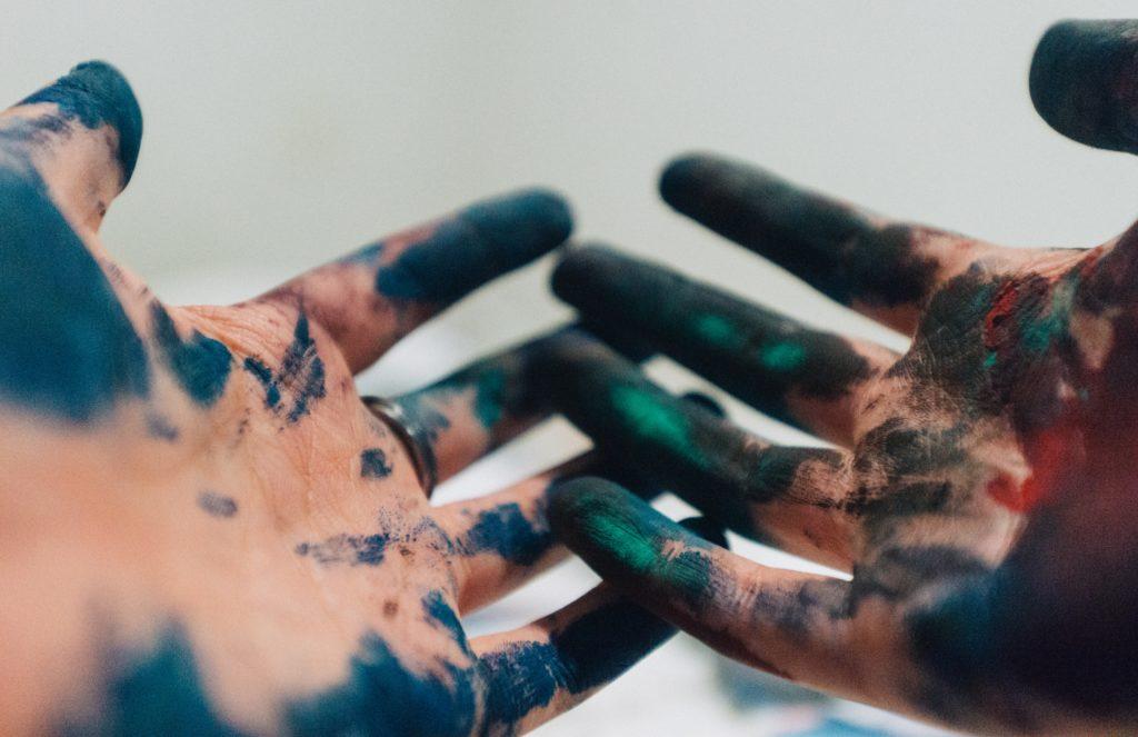 Hands full of paint