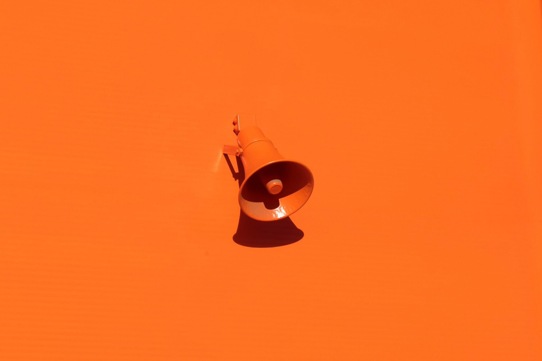 Orange microphone on orange background