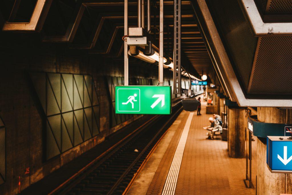 Emergency exit sign in underground station