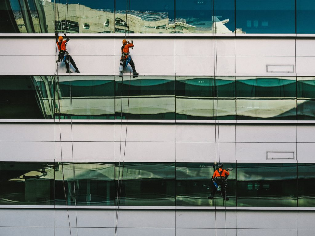 Window cleaners on building facade