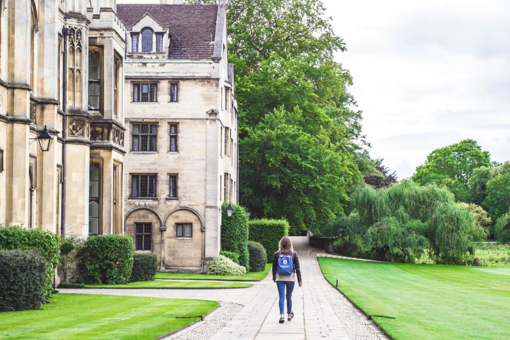 Student walking around campus in Cambridge