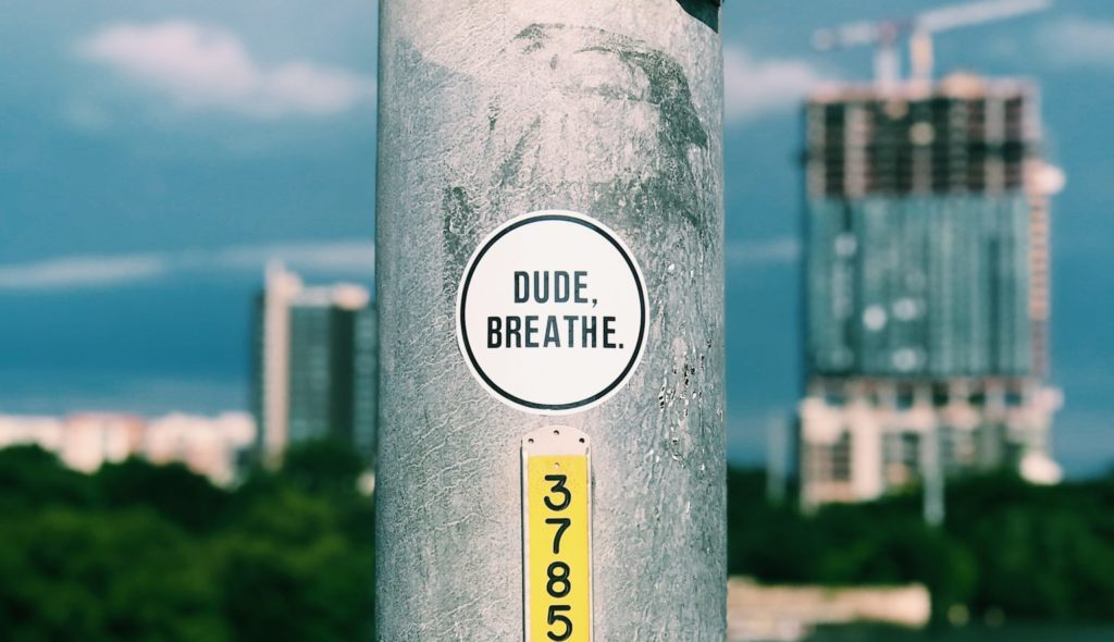 "PhD Meditation: ""Dude, Breathe"" Sticker on Landpost"